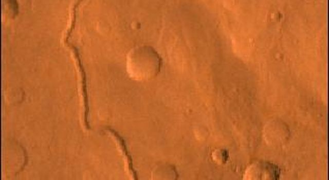 Scamander Vallis on Mars; north toward top. This scene shows heavily cratered highlands dissected by the slightly sinuous gully of Scamander Vallis, as seen by NASA's Viking spacecraft.