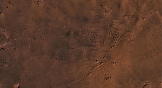 Tyrrhena Patera Region of Mars. Theis scene shows a central circular depression surrounded by circular fractures and highly dissected horizontal sheets, as seen by NASA's Viking spacecraft.