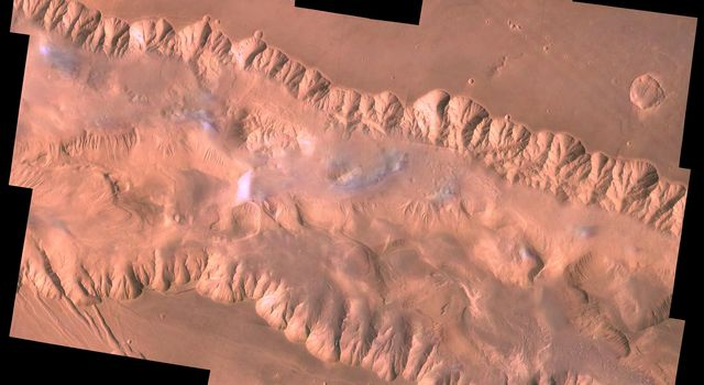 This view from NASA's Viking Orbiter 1 shows east Candor Chasma, one of the connected valleys of Valles Marineris. The Viking 1 craft landed on Mars in July of 1976.
