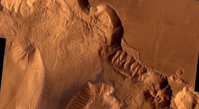 During its examination of Mars, NASA's Viking 1 spacecraft returned images of Valles Marineris, a huge canyon system, whose connected chasma or valleys may have formed from a combination of erosional collapse and structural activity.