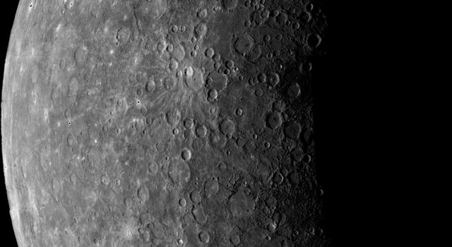 The first image of Mercury acquired by NASA's Mariner 10 in 1974. Mariner 10's trajectory brought it behind the lighted hemisphere of Mercury in order to acquire important measurements with other instruments.