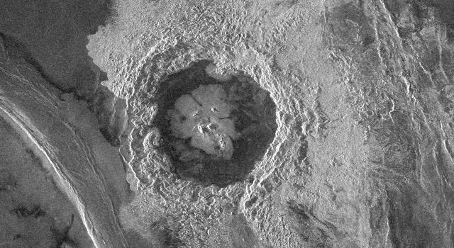 This image from NASA's Magellan spacecraft is from the northeastern Atalanta Region of Venus. The image shows the complex impact crater, Dickinson, characterized by a partial central ring and a floor flooded by radar-dark and radar-bright materials.