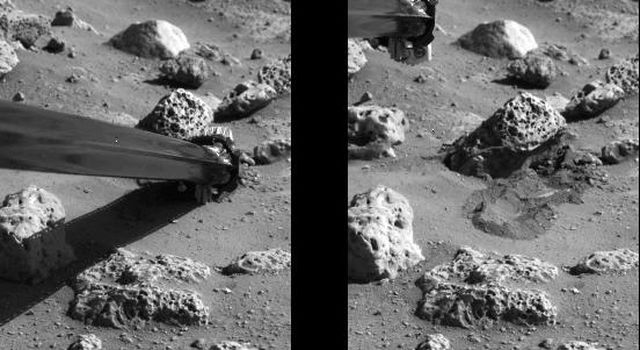 NASA's Viking 2's soil sampler collector arm successfully pushed a rock on the surface of Mars during the afternoon of Friday, Oct. 8, 1977.