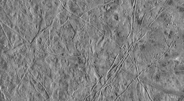 This image of Europa, an icy satellite of Jupiter, was obtained from a range of 39028 miles (62089 kilometers) by NASA's Galileo spacecraft during its fourth orbit around Jupiter and its first close pass of Europa.