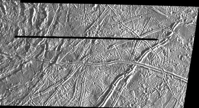 This image of Jupiter's satellite Europa was obtained from a range of 7364 miles (11851 km) by NASA's Galileo spacecraft during its fourth orbit around Jupiter and its first close pass of Europa.