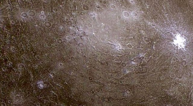 Low-resolution color data were combined with a higher resolution mosaic from NASA's Galileo spacraft to produce this infrared composite image of a pair of ancient multi-ringed impact basins on Jupiter's moon, Callisto.