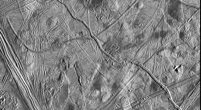 This view of the surface of one of Jupiter's moons, Europa, taken by NASA's Galileo spacecraft on Feb. 20, 1997, shows the complex icy crust that has been extensively modified by fracturing and the formation of ridges.