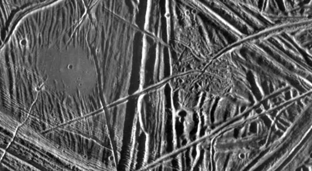 This close-up view of the icy surface of Europa, a moon of Jupiter, was obtained on December 20, 1996, by the Solid State Imaging system on board NASA's Galileo spacecraft during its fourth orbit around Jupiter.