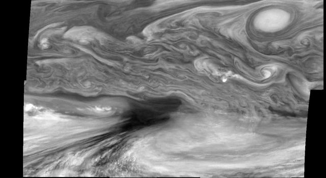 This photographic mosaic of images covering an area of 34,000 kilometers by 22,000 kilometers (about 21,100 by 13,600 miles) in Jupiter's equatorial region was taken by NASA's Galileo orbiter on December 17, 1996.