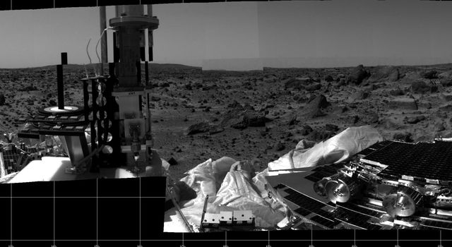 This photomosaic was taken by NASA's Imager for Mars Pathfinder (IMP) camera on July 4, 1997 between 4:00-4:30 p.m. PDT. The foreground is dominated by the lander, newly renamed the Sagan Memorial Station after the late Dr. Carl Sagan.
