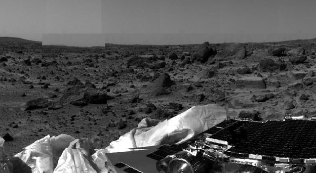 NASAs undeployed Sojourner rover is seen still latched to a lander petal in this image, taken on July 4, 1997, the lander's first day on Mars. Portions of a petal and deflated airbag are in the foreground.