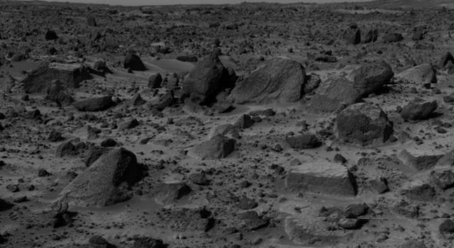 'Flat Top,' the rectangular rock at lower right, is part of a stretch of rocky terrain in this image, taken by NASA's deployed Imager for Mars Pathfinder (IMP) on July 7, 1997.