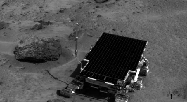 Sojourner is visible in this image, one of the first taken by NASA's deployed Imager for Mars Pathfinder (IMP) on July 7, 1997.