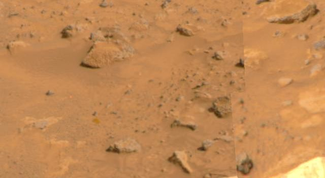 An area of Pathfinder's deflated airbags is visible in the lower portion of this image, taken by NASA's Imager for Mars Pathfinder (IMP) on July 8, 1997. Misregistration at the right side of the image is due to parallax.