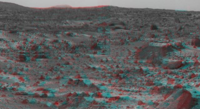 NASA's Mars Pathfinder's forward rover ramp can be seen successfully unfurled in this image, taken in stereo by the Imager camera. The large rock dubbed 'Wedge' is at lower right. 3-D glasses are necessary to identify surface detail.