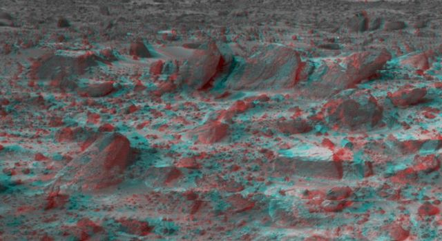Many prominent rocks near the Sagan Memorial Station are featured in this image, from NASA's Mars Pathfinder. Wedge is at lower left; Shark, Half-Dome, and Pumpkin are at center. 3D glasses are necessary to identify surface detail.