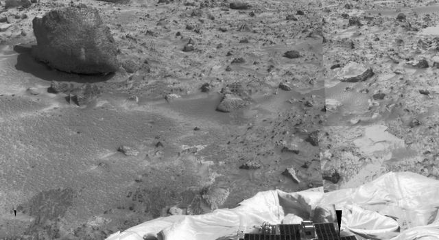 The left portion of this image, taken by NASA's Imager for Mars Pathfinder (IMP) on July 7, 1997, shows the large rock nicknamed 'Yogi.' Portions of a petal and deflated airbag are in the foreground.