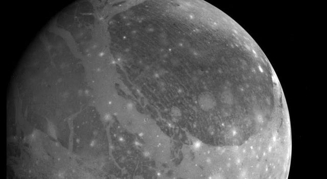 View of Ganymede from NASA's Galileo spacecraft during its first encounter with the satellite, taken on June 26, 1996.