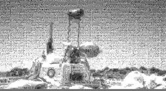 One of the two forward cameras aboard NASA's Sojourner rover took this image of the Sagan Memorial Station on Sol 25. The camera uses a fisheye lens which produces the illumination gradient in the sky on the western horizon. Sol 1 began on July 4, 1997.