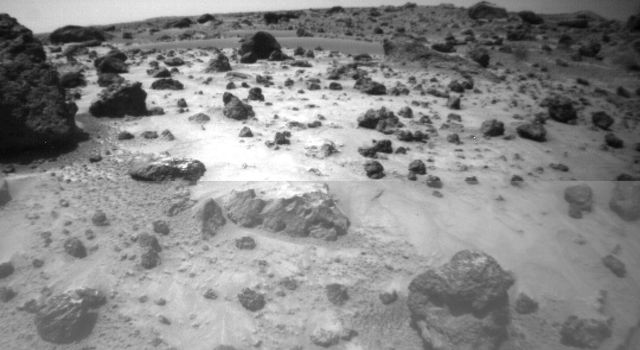 One of the two forward cameras aboard NASA's Sojourner imaged this area of Martian terrain on Sol 26. The large rock dubbed 'Pooh Bear' is at far left, and stands between four and five inches high. Sol 1 began on July 4, 1997.