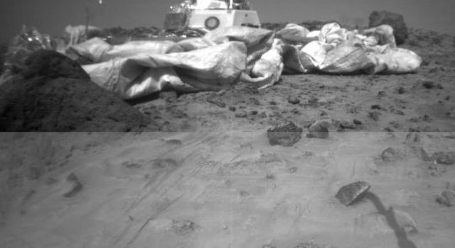 One of the two forward cameras aboard NASA's Sojourner rover took this image of the Sagan Memorial Station on Sol 26. The angular resolution of the camera is about three milliradians per pixel, which is why the image appears grainy.