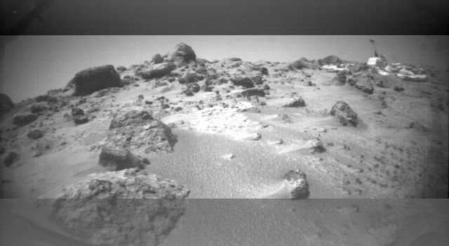 This image was taken by NASA's Sojourner rover's left front camera on Sol 32. The Pathfinder lander is at right and is about 9 meters away. Sol 1 began on July 4, 1997.