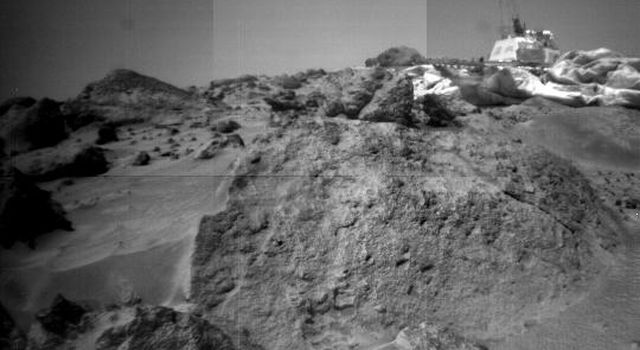 This image was taken by NASA's Sojourner rover's right front camera on Sol 33. The rock in the foreground, nicknamed 'Ender,' is pitted and marked by a subtle horizontal texture. Sol 1 began on July 4, 1997.
