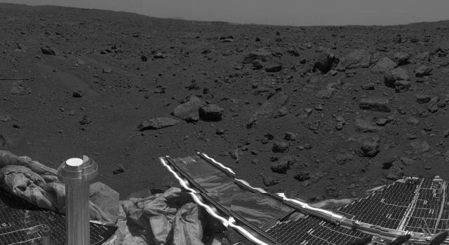 This image shows the area where NASA's Sojourner rover is currently exploring. Having just investigated the Mermaid Dune, at left center, the rover is now heading toward the assemblage of large rocks at right. Sol 1 began on July 4, 1997.