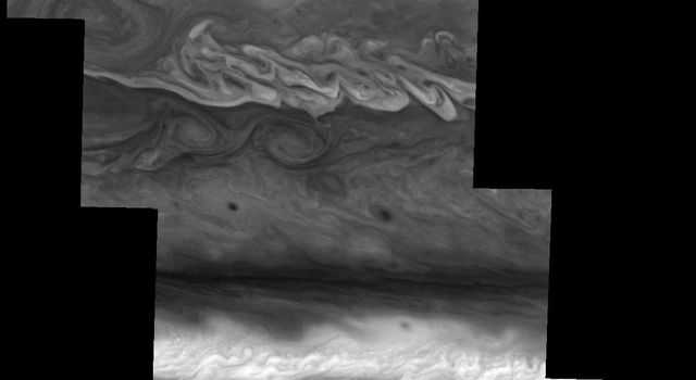 This mosaic shows the features of Jupiter's main visible cloud deck and the hazy cloud layer above it as seen by NASA's Galileo spacecraft on April 3, 1997.