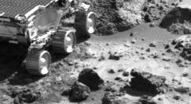 This image, taken by NASA's Imager for Mars Pathfinder (IMP) at the end of Sol 35, shows the Sojourner rover heading toward a rock called 'Wedge.' Sol 1 began on July 4, 1997.