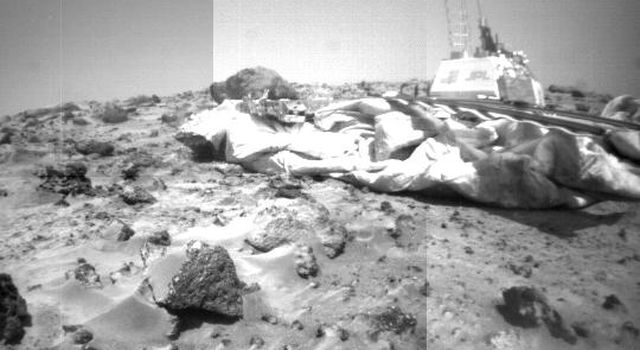 This mosaic of NASA's Mars Pathfinder lander and Martian terrain was taken by the front camera on the Sojourner rover on Sol 39. Sol 1 began on July 4, 1997.