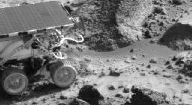 The Sojourner rover is next to the rock 'Wedge' in this image taken on Sol 35 by NASA's Imager for Mars Pathfinder (IMP). Sol 1 began on July 4, 1997.