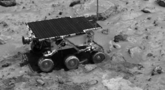 NASA's Imager for Mars Pathfinder (IMP) caught this image of the rover as it was digging in the 'compressible' material near the rock Casper to determine the soil's mechanical properties on Sol 23. Sol 1 began on July 4, 1997.