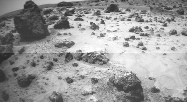 This image, taken NASA's Sojourner's front right camera, was taken when the rover was next to Poohbear (rock at left) and Piglet (not seen) as it looked out toward Mermaid Dune. Sol 1 began on July 4, 1997.