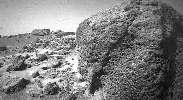 This view of the rock 'Chimp' was acquired by NASA's Sojourner rover's right front camera on Sol 74. A large crack, oriented from lower left to upper right, is visible in the rock.  Sol 1 began on July 4, 1997.