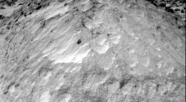 A close-up view of the rock 'Moe' in the Rock Garden at the Pathfinder landing site. Moe is a meter-size boulder that, as seen from NASA's Sojourner, has a relatively smooth yet pitted texture upon close examination. Sol 1 began on July 4, 1997.