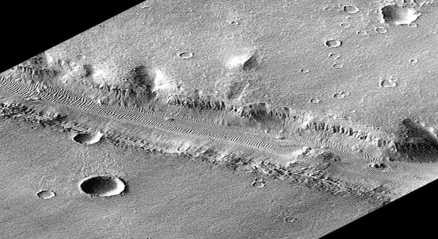 This is the full-resolution, rotated perspective image of Nirgal Vallis, was taken on September 21, 1997, by NASA's Mars Global Surveyor. Nirgal Vallis is one of a number of canyons called valley networks or runoff channels.