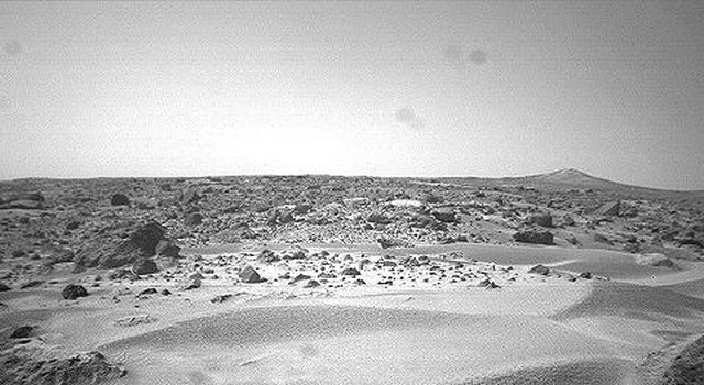 This is the right image of a stereo pair taken by NASA's Sojourner rover in the area behind the 'Rock Garden' at the Pathfinder landing site and gives a view of the Martian surface not seen from the lander. Sol 1 began on July 4, 1997.