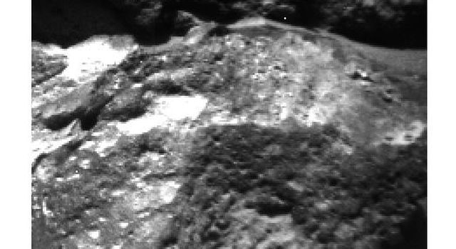 This 1997 close-up from NASA's Mars Pathfinder Sojourner rover is of a small rock shows that weathering has etched-out pebbles to produce sockets. In the image, sunlight is coming from the upper left.