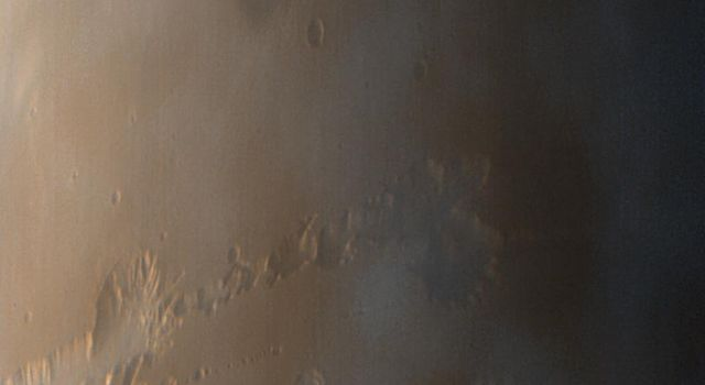 This image from NASA's Mars Global Surveyor taken on Oct. 3, 1997, shows late afternoon clouds and hazes that are concentrated within the Valles Marineris canyon system.