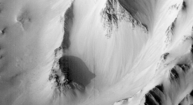 NASA's Mars Global Surveyor captured this image of a type of bedrock layering had never been seen before in Valles Marineris, Mars.