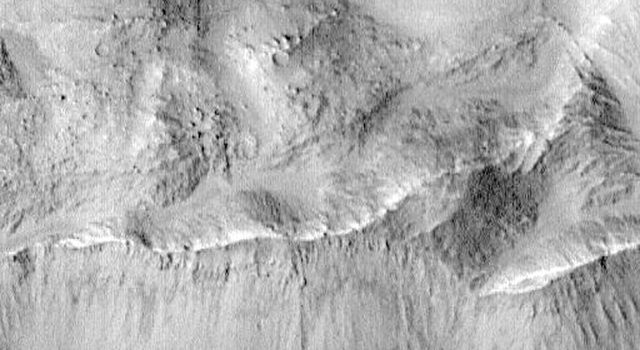 Complex floor deposits within Western Ganges Chasma, Valles Marineris are evident in this image taken by NASA's Mars Global Surveyor.