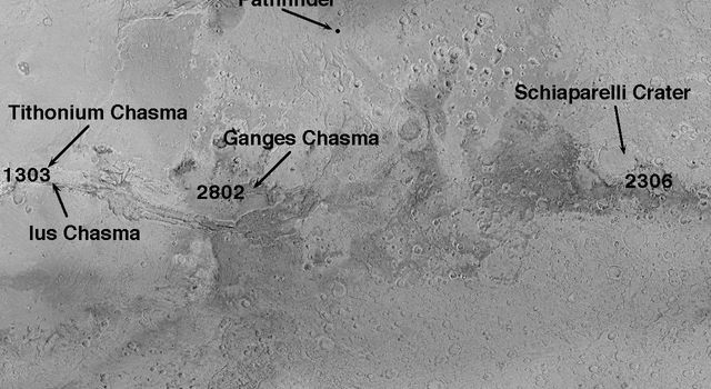 Low sunlight conditions and NASA's Mars Global Surveyor relative distance provide a low resolution view of the Tithonium/Ius Chasma, Ganges Chasma, and Schiaparelli Crater on Mars.