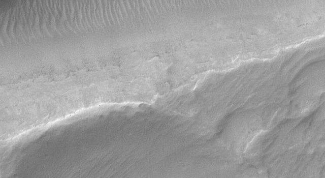This view captured NASA's Mars Global Surveyor crosses one of the troughs of the Sirenum Fossae on the martian planet.