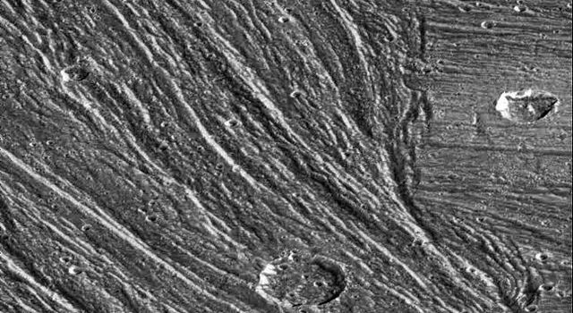 Complex sets of ridges and grooves are visible in this image of the Nippur Sulcus region on Jupiter's largest moon Ganymede. NASA's Galileo spacecraft imaged this region as it passed Ganymede during its second orbit through the Jovian system.