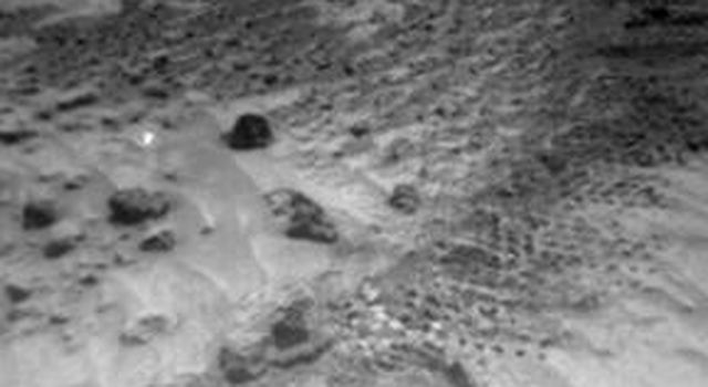 NASA's Sojourner Rover image of rounded 4-cm-wide pebble (lower center)  and excavation of cloddy deposit of 'Cabbage Patch' at lower left. Note the bright wind tails of drift material extending from small rocks. Sol 1 began on July 4, 1997.