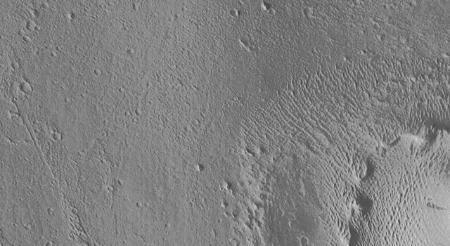 An exotic terrain of wind-eroded ridges and residual smooth surfaces is seen in images acquired October 18, 1997 by NASA's Mars Global Surveyor (MGS) and by the Viking Orbiter 1 twenty years earlier.