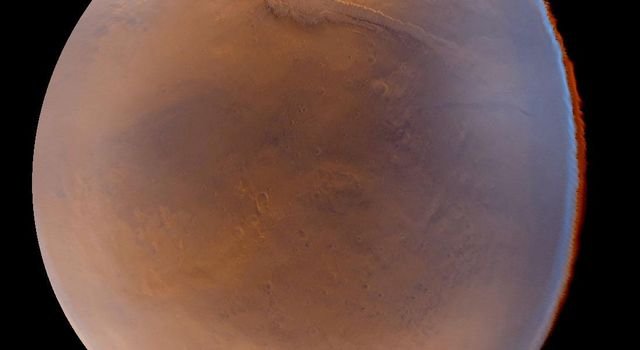 NASA's Mars Global Surveyor acquired this image of Mar's seasonal south polar carbon dioxide frost cap at the bottom and a portion of the Valles Marineris stretching across the upper quarter of the picture.