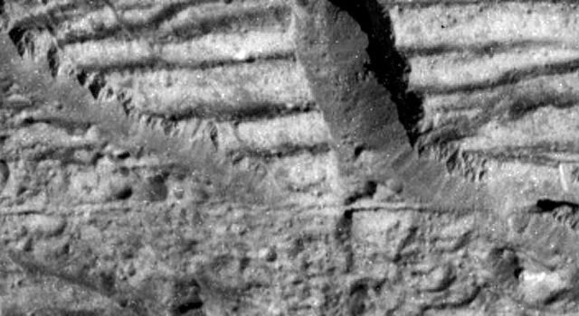 This image, taken by the camera onboard NASA's Galileo spacecraft, is a very high resolution view of the Conamara Chaos region on Jupiter's moon Europa. It shows an area where icy plates have been broken apart and moved around laterally.
