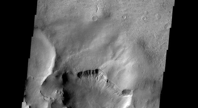 This closed depression is located in Noachis Terra on Mars. To the south a channel leads to second region of erosion. This image is from NASA's Mars Odyssey spacecrafft.